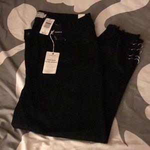 Black Torrid High Rise Ultra Skinny jeans.